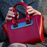 Red ladies handbag closeup. Fashion accessory royalty free stock photo