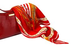 Red ladies' handbag and scarf isolated on white Royalty Free Stock Photo