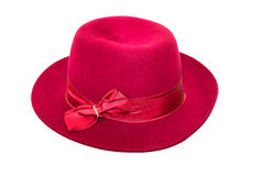 Red ladies hat. Made of rabbit fluff decorated with a bow of ribbon isolated on white background Royalty Free Stock Images