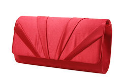 Red ladies pouch on white background. Luxury clutch bag Stock Photo
