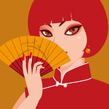Red lady. A woman holding a folding fan Stock Photo