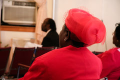 Red lady. NEW YORK CITY - JUNE 22: Black people celebrating a religious service in a little congregation church of Harlem  neighborhood, New York on June 22 Royalty Free Stock Photo