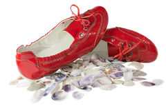 Red lady ballet flat shoes and seashells isolated Royalty Free Stock Images