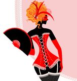 Red lady in corset with fan Royalty Free Stock Image