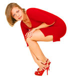 Red Lady Fixing Shoe Stock Photography