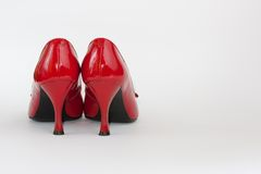 Red lady's shoes in left Stock Photography