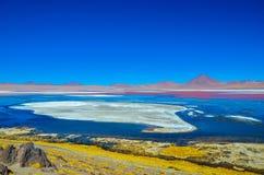 Red Lagoon, Eduardo Avaroa Andean Fauna National Reserve, Bolivia. The Red Lagoon (Laguna Colorada), surrounded by the arid mountain landscape Stock Image