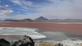 Red lake. This photograph was taken in 'The Atacama' desert which borders both Chile and Bolivia and it is the driest desert in the world. The reason of it's Stock Photography