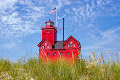 Lake Michigan red lighthouse Stock Images