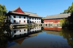 Red Lake in Peking University. Red Lake with reflections of old buildings in water in Peking University royalty free stock image