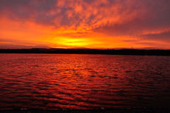 Red lake at sunrise Stock Photo