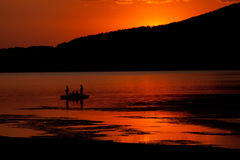 Red lake sunset Stock Images