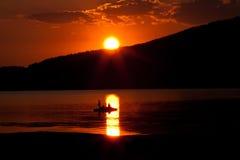 Red lake sunset Stock Photos