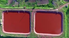 Red lakes in Kryvyi Rih, Ukraine, aerial photo. Red lakes in industrial part of Kryvyi Rih, Ukraine, aerial shoot stock video footage
