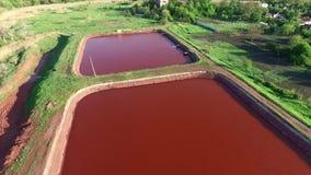 Red lakes in Kryvyi Rih, Ukraine, aerial photo. Red lakes in industrial part of Kryvyi Rih, Ukraine, aerial shoot stock footage