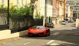 Red Lamborghini on London streets royalty free stock photos