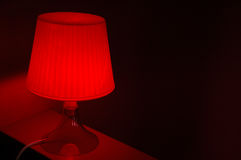 Red lamp. Modern Red lamp in a house Stock Photography