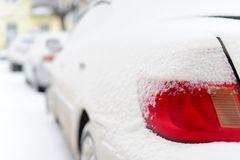 The red lamp of the car in snowy winter. Stock Photos