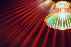 Red lamp, close-up. Red lamp in stripes, close-up, soft-focus, abstract Stock Images