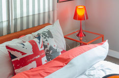 Red lamp on glass table in modern bedroom Royalty Free Stock Photos