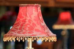 Red lamp shade reflecting in mirror Stock Image