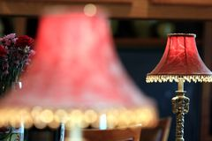 Red lamp shade reflecting in mirror Royalty Free Stock Image