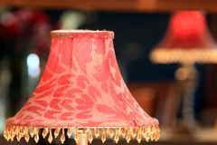 Red lamp shade reflecting in mirror Royalty Free Stock Photos