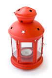 Red lamp with stars. And candle on white background Stock Photography