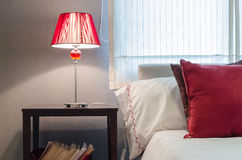 Red lamp on table in bedroom Stock Photo