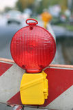Red lamp to signal roadworks and road works in progress Stock Photo