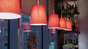 Red lamps indoors stock video footage