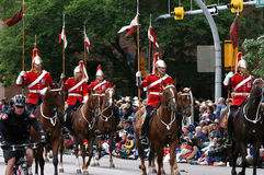Red lancers riding in parade Stock Photography