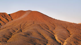 Red land in the Mud Volcanoes Reservation, Romania Stock Images