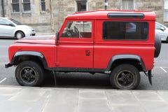 Red Land Rover Defender 110. EDINBURGH, UK - CIRCA AUGUST 2015: red Land Rover Defender 110 parked on a street in the city centre Stock Image