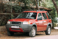 Red Land Rover Freelander on street. Tbilisi, Georgia - October 21, 2016: Land Rover Freelander is a compact sport utility vehicle, SUV, which was produced by Stock Photos