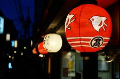 Red Lantern Along a Street in Kyoto. A red lantern along a street in the Gion district of Kyoto Royalty Free Stock Photography