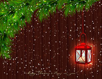 Red lantern with candle, Christmas tree branches, twigs and brow Royalty Free Stock Photo
