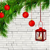 Red lantern with candle, fir twigs on white brick wall Stock Images