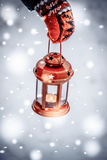 Red lantern candle in hand Royalty Free Stock Image