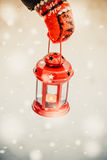 Red lantern candle in hand Stock Photos