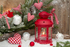 Red lantern with candlelights an checked heards for a christmas Stock Photography