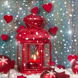 Red lantern with candlelights and shnowflakes - christmas atmosp Royalty Free Stock Photos