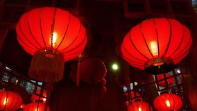 Red Lantern Hang on Ceiling. A Pair of Red Lantern Hang on Ceiling with few at the background Royalty Free Stock Photos