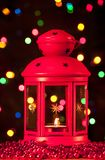 Red lantern. With a lighted candle inside Stock Photo