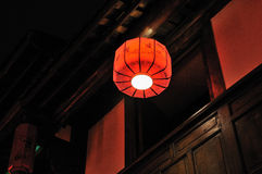 Red lantern outside of the window Stock Photo