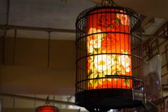 A Lantern Placed In A Bird Cage In A Shop stock photo