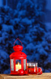 Red lantern, steaming cup of tea and red apples Royalty Free Stock Images