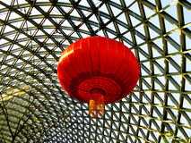 Red lantern on Tropical Exhibition Greenhouse roof Stock Photo