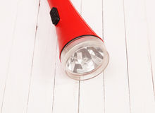 Red lantern on a white table. Red lantern on a white wooden table Royalty Free Stock Photo
