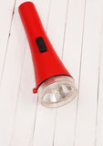Red lantern on a white table. Red lantern on a white wooden table Royalty Free Stock Photography
